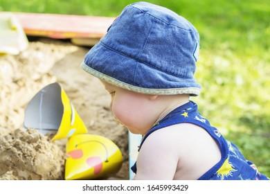 Little boy playing in the sandbox