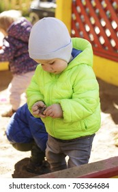 the little boy playing in the sandbox