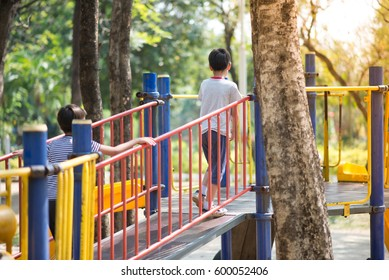 Little boy playing slider at playground