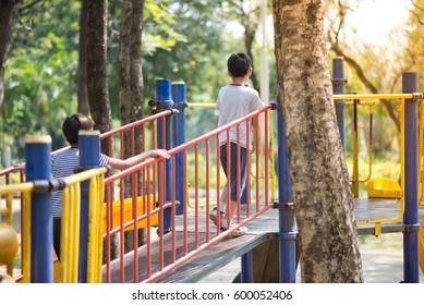 Little boy playing slider at playground