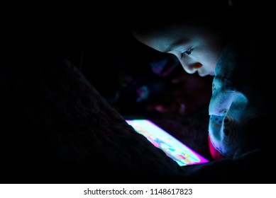 Little Boy Playing With Smartphone In The Dark , Kids Addict Playing Smartphone