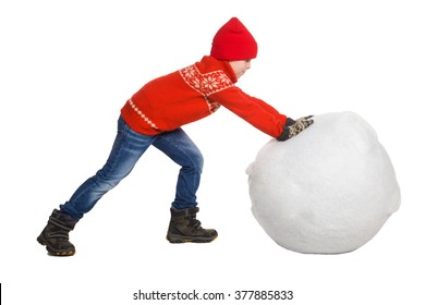 Little boy playing in the snow, isolated on white background. Children in winter. Happy kid making a big snowball for snowman