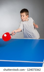 Little Boy playing table tennis
