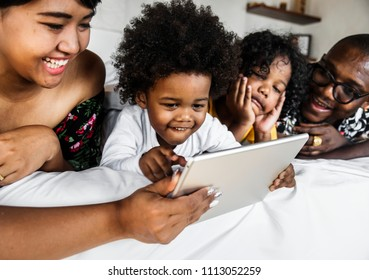 Little boy playing with a tablet