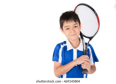 Little boy playing tennis racket and tennis ball in hand