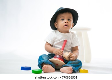 The little boy playing with toys