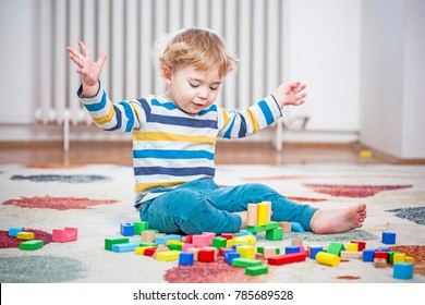 Little boy playing with toys in his room