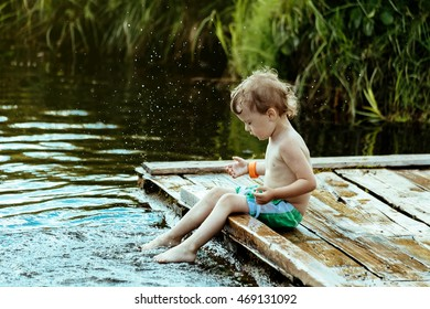 little boy playing in water