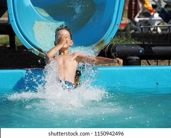Little boy playing in a water park