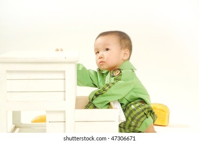A little boy playing in a white background