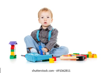 Little boy plays in the builder with tools. isolated over white background.