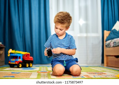 the little boy plays cars