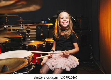 little boy plays drums in recording studio