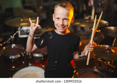 little boy plays drums in recording studio
