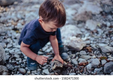 Little boy plays near dry bed of river Tara in Montenegro. Scenic view