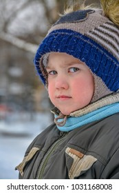 A little boy plays on the Playground.  A walk on a winter day.