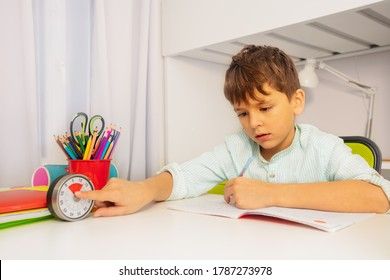 Little boy point to timer during development therapy lesson on background