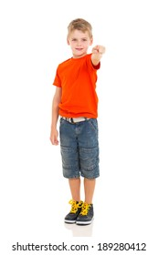 little boy pointing at the camera