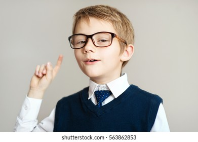 Little boy pointing his finger up. education. learning