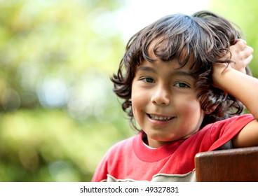 Little boy portrait at the park smiling