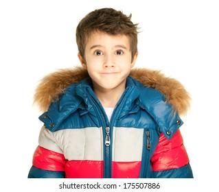 Little boy portrait in winter jacket isolated on white