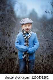 Little boy posing in outdoor. Handsome caucasian little boy.