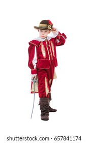 Little boy posing in red musketeer suit with sword. Isolated on white