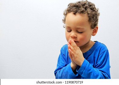 little boy praying