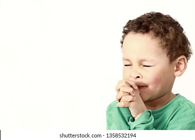 little boy praying to God with hands held together and  head held high stock photo