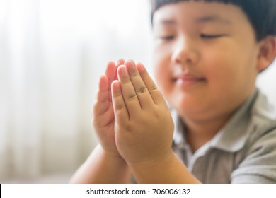 Little boy praying in the morning.Little asian boy hand praying,Hands folded in prayer concept for faith,spirituality and religion.