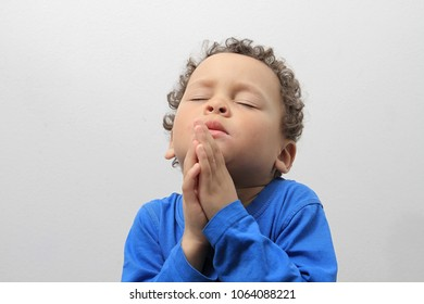 little boy praying on white background stock image of stock photo
