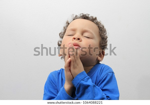 little boy praying on white background stock image of stock photo