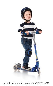 Little boy in protection helmet and in the knee and arm ruffles riding his scooter isolated on white background