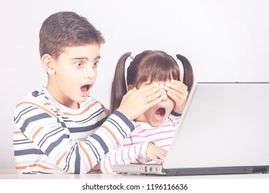 Little boy protects his sister from watching inappropriate content while using a computer. Internet safety for kids concept