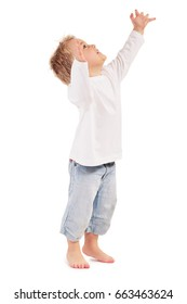 LITTLE BOY PUTTING HIS HANDS UP ISOLATED OVER WHITE BACKGROUND