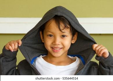 Little boy rapper on street