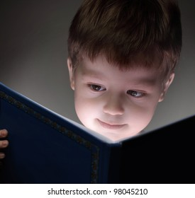 little boy read book