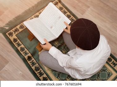 little boy read the Quran