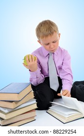 Little boy reading a book. on blue background
