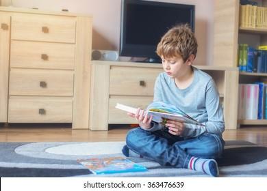 Little boy reading a fairy tale