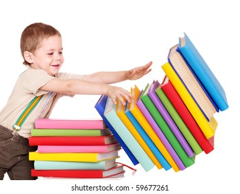 Little boy reading pile of books.