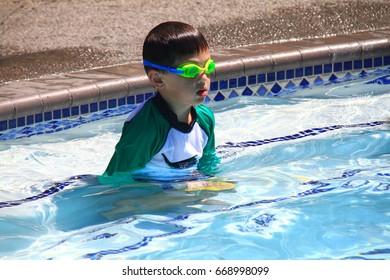 Little boy ready to swim in pool