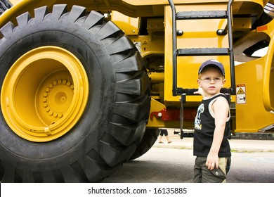 Little boy ready to work on a construction truck
