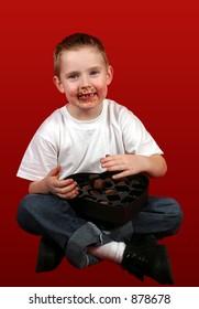 A little boy really enjoying his candy.