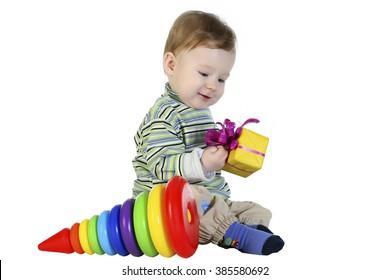 little boy receives a gift .Focus at face