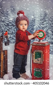 little boy in red sweater standing in the winter forest fairy and playing with children's gas station