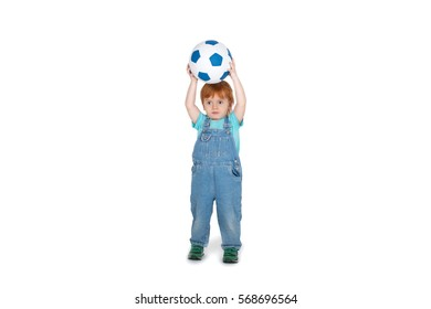 the little boy with red-hair catches a soccer ball