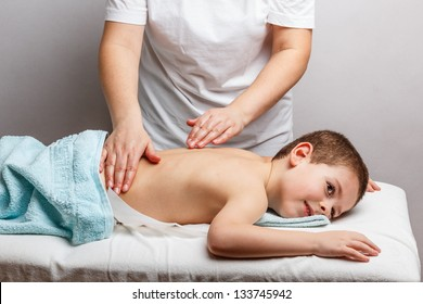 Little boy relaxing with hand massage