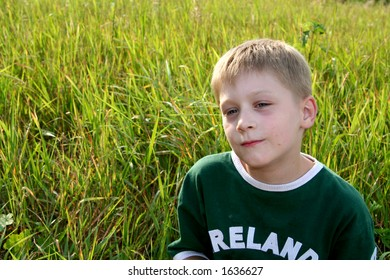Little boy resting on the grass