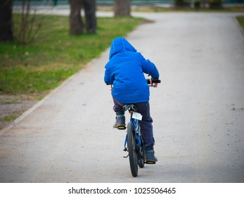 LIttle boy riding a bicycle a few days after the first try.